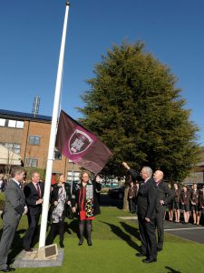 HRH The Duke of Gloucester unfurls the new school flag