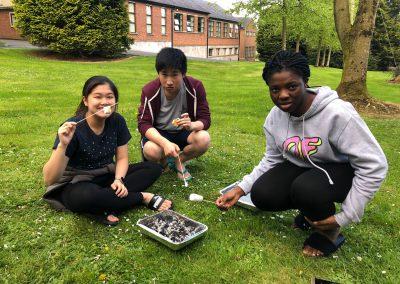 Angie Lam, Odo Pang & Eri Alabi toasting marshmallows