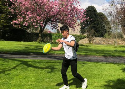 Benson Chan enjoying playing rugby in the front garden at RSD
