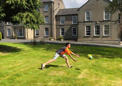 Harold NG practising Rugby