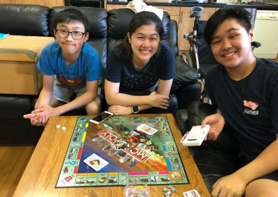 Harold Ng, Angie Lam and Peter Chan having fun playing board games together