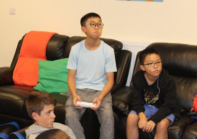 Junior boys enjoying playing in the games room