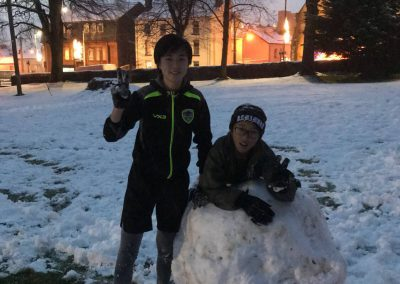 Kelvin and Harold making a snowman