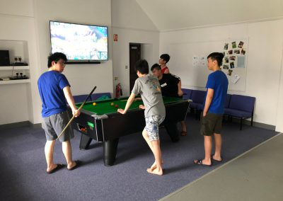 Playing pool in the boys TV Room